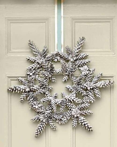 Christmas Pinecone Crafts for Kids and Adults - snowy pinecone wreath #christmas #crafts #diy #pinecones #holidays #xmas #christmascrafts