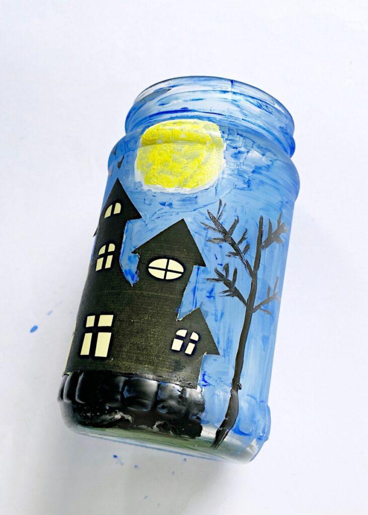 How to make a haunted house mason jar luminary
